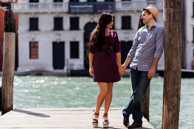 Yulia and Pavel on a dock during their honeymoon photo session in Venice