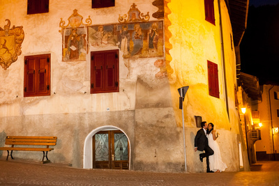 just married couple pose in a small mountain village during a photo shooting in Northern Italy