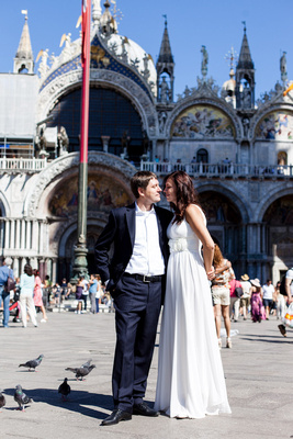 Russian couple kiss in San Marco Square during a wedding photo service in Venice