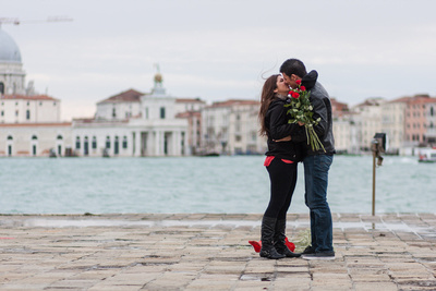 couple hugging during engagement photo service in Venice