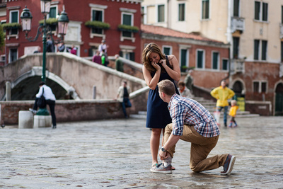 Young American boy proposes during an engagement photo shooting in Venice