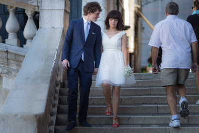 British couple walking in Venice during wedding photo reportage
