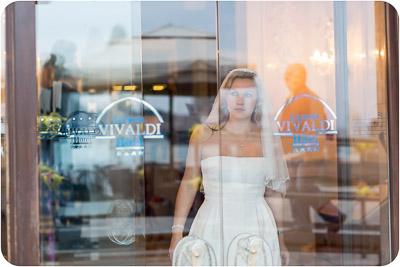 bride standing in front of hotel window in Venice