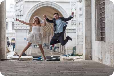 Russian couple jumping during honeymoon photo service in Venice