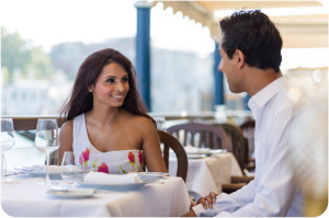 couple at breakfast during engagement photo session in Venice