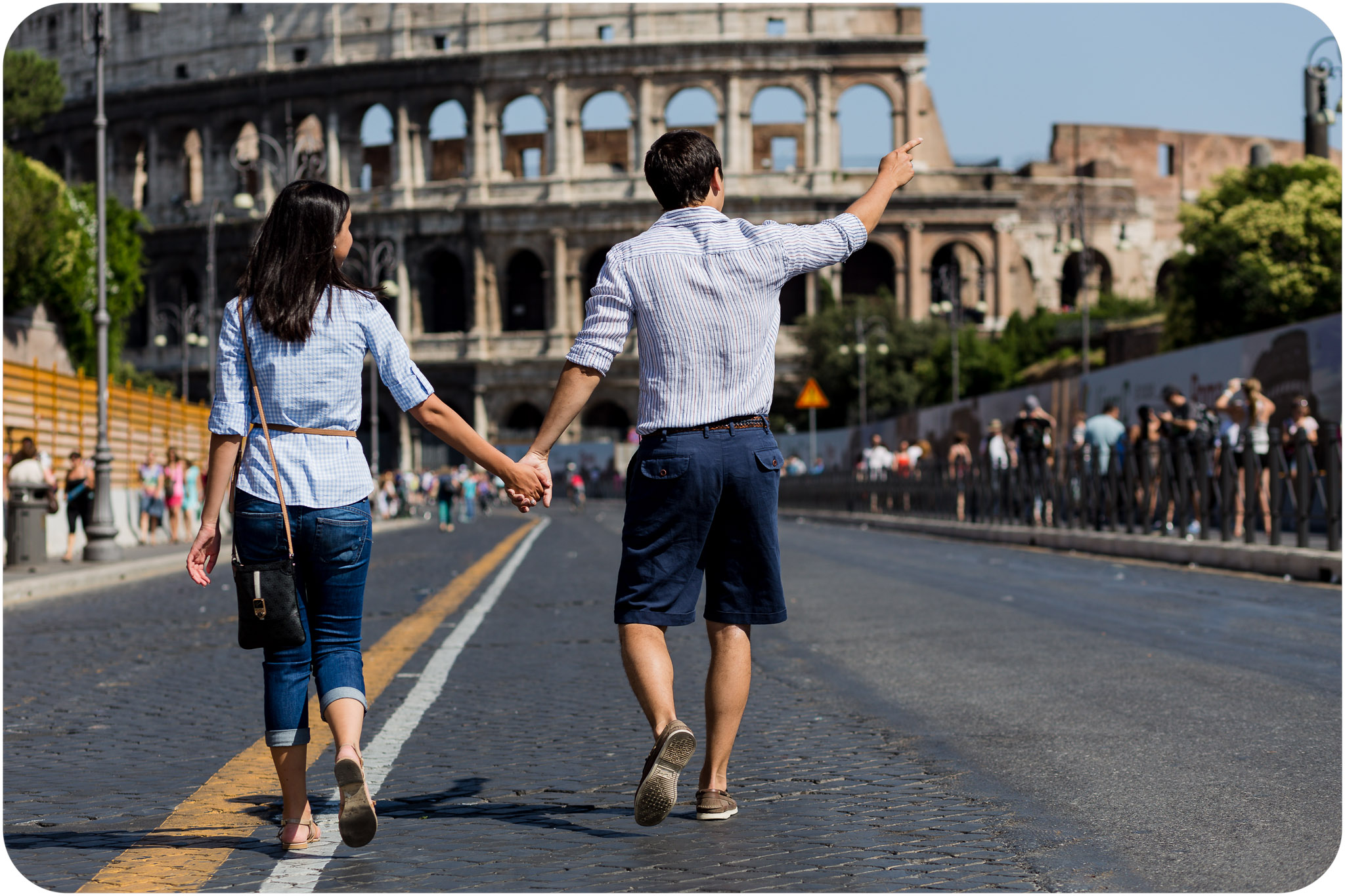 couple walking near the Colisseum during honeymoon photo service in Rome