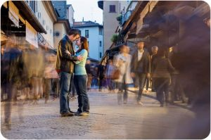 couple hugging in Florence during engagement photo session