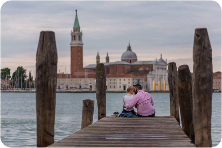 couple hugging during engagement photo session in Venice dawn