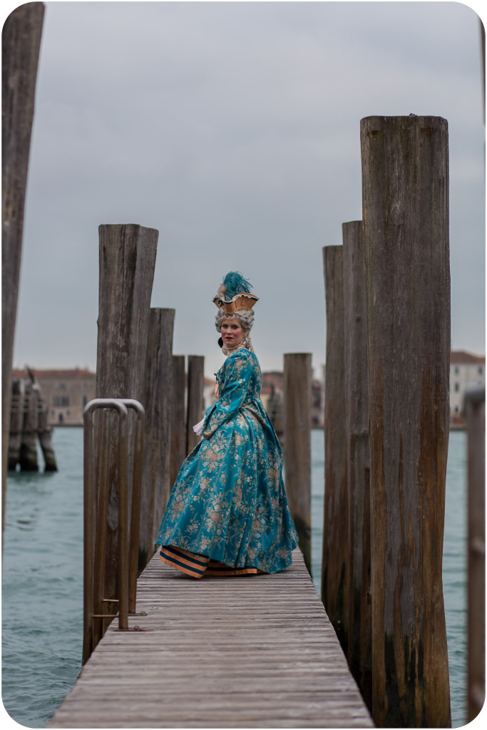 woman dressed-up in carnival costume during couple photo portrait in Venice