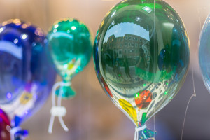glass baloons and a couple during pre-wedding photo service in murano