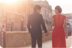 couple walking during pre wedding photo session in Venice