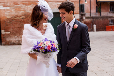bride and son walk in Venice during vows renewal photo service