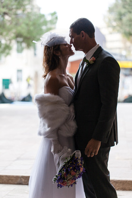 couple kissing during vow renewal photo service