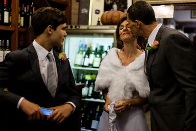 bridegroom kissing the bride during vows renewal photo shooting