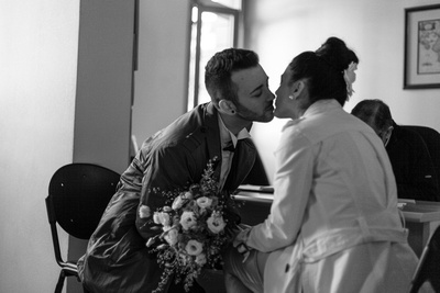 Greek couple kissing at the Greek consulate during wedding photo service in Venice