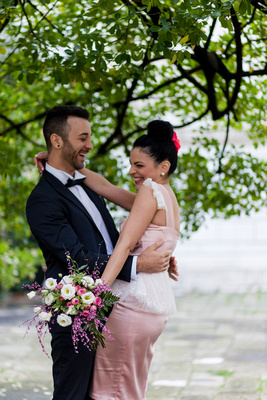 Greek couple hugging during informal wedding photo service in Venice