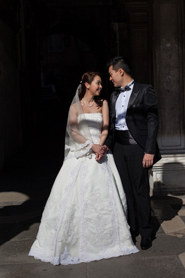 Asian couple standing during a pre-wedding photo shooting in Venice