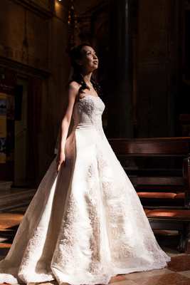 bride standing in a church during a pre-wedding photo service