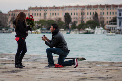 firefighter proposing to his girlfriend during an engagement photo shooting in Venice