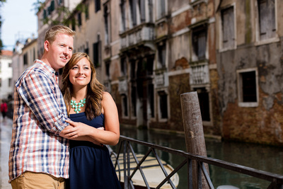 Young American couple hugging during an engagement photo service in Venice