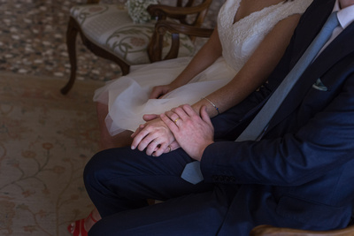 bride and groom holding hands in wedding photo session in Venice