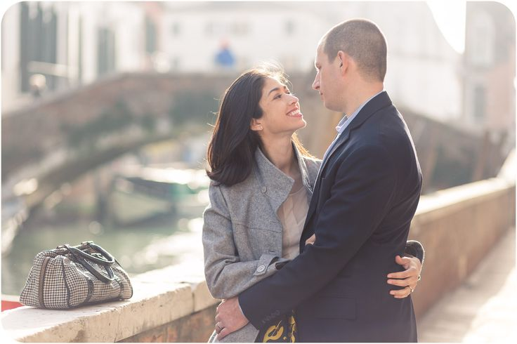 couple hug during couple photo session in Venice