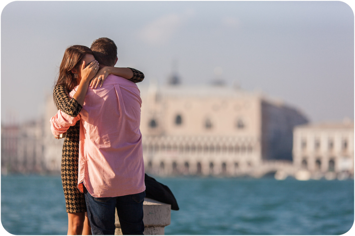 couple hugging during surprise engagement photo service in Venice