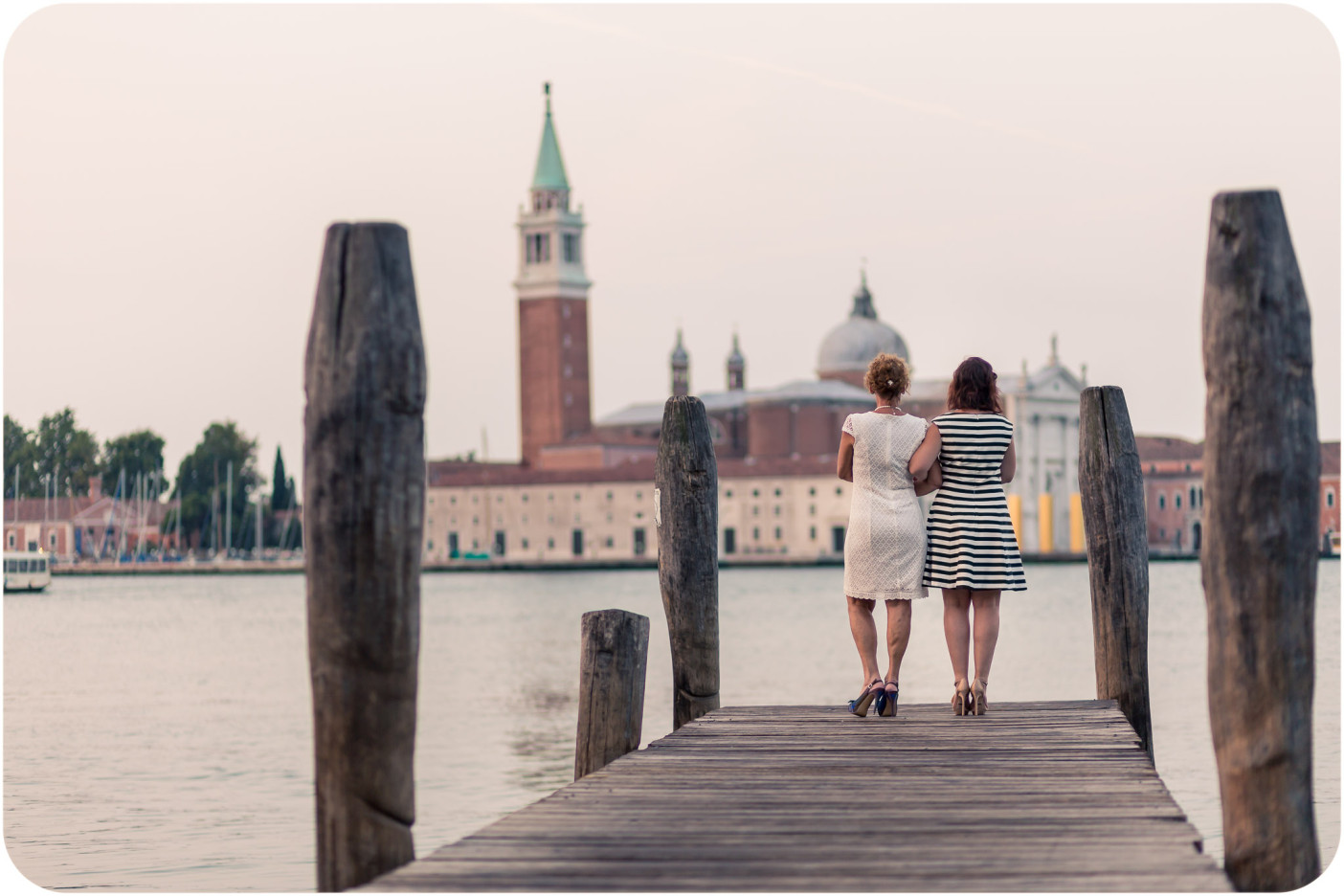 mum and daughter during family photo portrait in venice