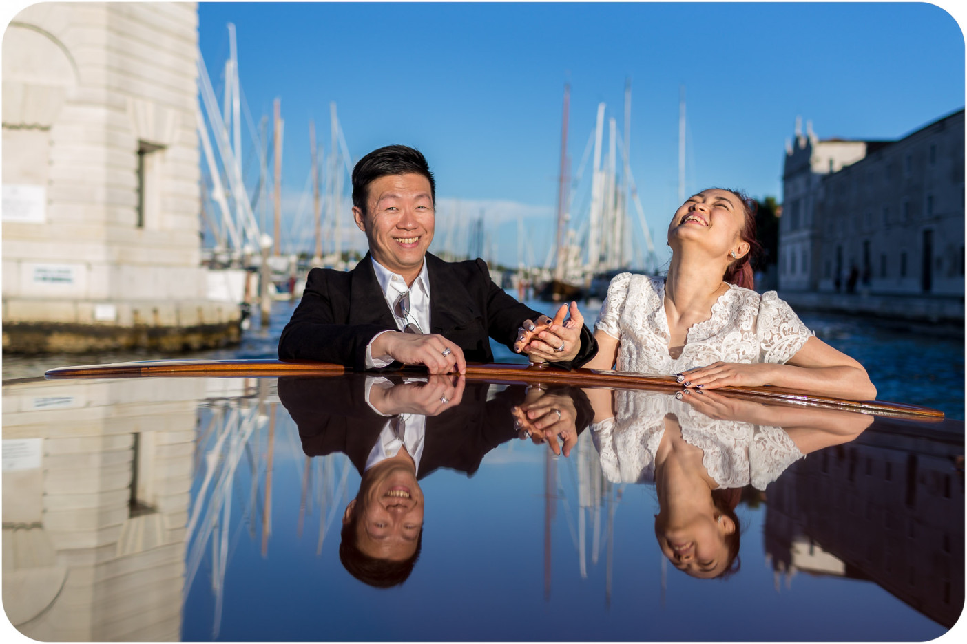 couple smiling during surprise wedding proposal photo session in Venice