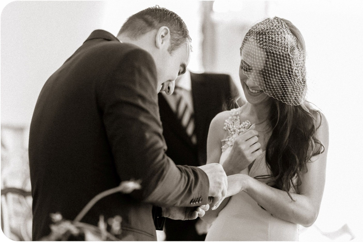 bride and groom exchanging rings during wedding photo service in Venice