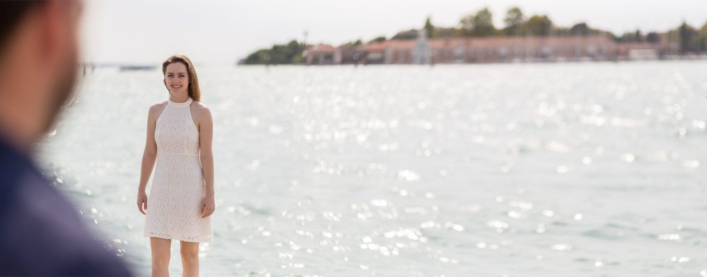 would-be bride smiles during engagement photo service in Venice