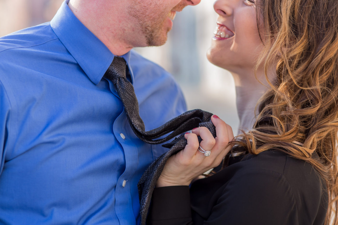 couple hugging during engagement photo session